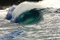 Backlit wave at Waimea bay shorebreak on the North Shore of Oahu, Hawaii.