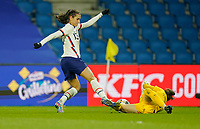 LE HAVRE, FRANCE - APRIL 13: Alex Morgan #13 of the United States meets advancing French goal keeper Solène Durand #1 during a game between France and USWNT at Stade Oceane on April 13, 2021 in Le Havre, France.