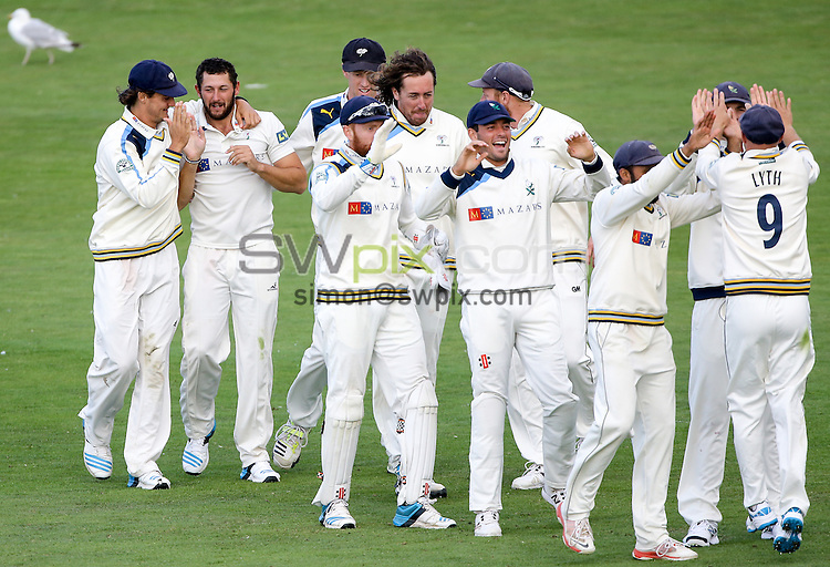 Picture by Alex Whitehead/SWpix.com - 17/08/2014 - Cricket - LV County Championship Div One - Yorkshire CCC v Sussex CCC, Day 3 - North Marine Road, Scarborough, England - Yorkshire celebrate wicket of Sussex's Craig Cachopa.
