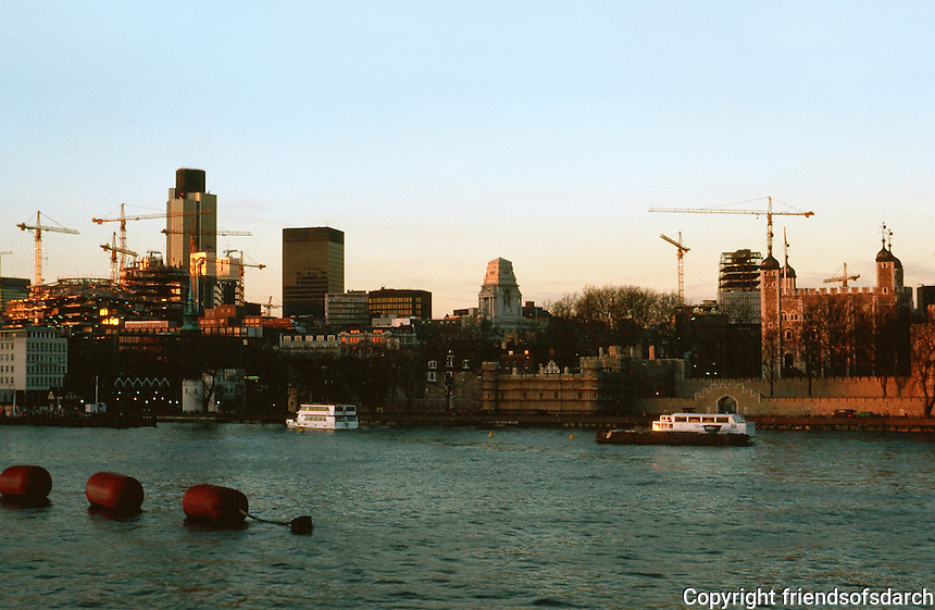 London:  Thameside-Walk #23.  Twilight--National Westminster Tower, left. The truncated pyramid tower, center, is the former Port of London Authority, 1912.  (Now, Willis Faber Insurance).  Tower at right.  Photo '90.