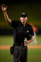 Home plate umpire Cas Cousins waves to the scoring booth between innings of an Arizona League game between the AZL Giants Orange and the AZL Cubs 1 on July 10, 2019 at Sloan Park in Mesa, Arizona. The AZL Giants Orange defeated the AZL Cubs 1 13-8. (Zachary Lucy/Four Seam Images)