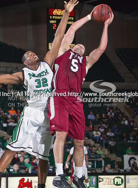 Troy Trojans guard/forward Justin Wright (5) and North Texas Mean Green forward Roger Franklin (32) in action during the game between the Troy Trojans and the University of North Texas Mean Green at the North Texas Coliseum,the Super Pit, in Denton, Texas. UNT defeats Troy 87 to 65.....