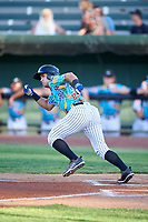 Idaho Falls Chukars Jose Marquez (13) starts running toward first base during a Pioneer League game against the Missoula Osprey at Melaleuca Field on August 20, 2019 in Idaho Falls, Idaho. Idaho Falls defeated Missoula 6-3. (Zachary Lucy/Four Seam Images)