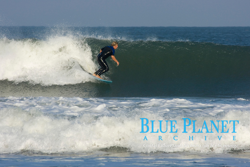 Surfers ride the winter waves off the beaches of the Outer Banks of North Carolina. (do) (no MR)