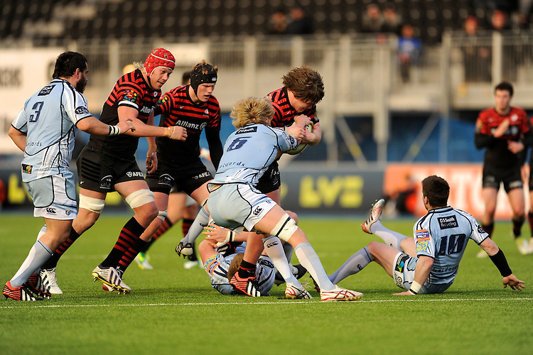 20130127 Copyright onEdition 2013©.Free for editorial use image, please credit: onEdition..Nick Auterac of Saracens is tackled by Luke Hamilton of Cardiff Blues as Mouritz Botha (left) and Tom Jubb of Saracens support during the LV= Cup match between Saracens and Cardiff Blues at Allianz Park on Sunday 27th January 2013 (Photo by Rob Munro)..For press contacts contact: Sam Feasey at brandRapport on M: +44 (0)7717 757114 E: SFeasey@brand-rapport.com..If you require a higher resolution image or you have any other onEdition photographic enquiries, please contact onEdition on 0845 900 2 900 or email info@onEdition.com.This image is copyright onEdition 2013©..This image has been supplied by onEdition and must be credited onEdition. The author is asserting his full Moral rights in relation to the publication of this image. Rights for onward transmission of any image or file is not granted or implied. Changing or deleting Copyright information is illegal as specified in the Copyright, Design and Patents Act 1988. If you are in any way unsure of your right to publish this image please contact onEdition on 0845 900 2 900 or email info@onEdition.com