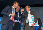 Brexit Party EU elections campaign launch at  The Neon in Newport, South Wales. Brexit Party Leader Nigel Farage alongside Brexit Party Chairman Richard Tice (left) and Brexit Party candidate Nathan Gill (middle) at the end of the event.