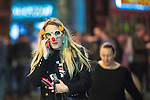"""© Joel Goodman - 07973 332324 . 17/12/2016 . Manchester , UK . A woman wearing novelty reindeer glasses . Revellers out in Manchester City Centre overnight during """" Mad Friday """" , named for being one of the busiest nights of the year for the emergency services in the UK . Photo credit : Joel Goodman"""