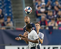 FOXBOROUGH, MA - JUNE 27: Teal Bunbury #10 heads the ball during a game between Philadelphia Union and New England Revolution at Gillette Stadium on June 27, 2019 in Foxborough, Massachusetts.
