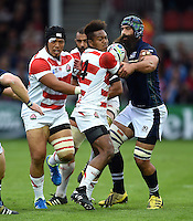 Kotaro Matsushima of Japan takes on the Scotland defence. Rugby World Cup Pool B match between Scotland and Japan on September 23, 2015 at Kingsholm Stadium in Gloucester, England. Photo by: Patrick Khachfe / Stewart Communications