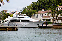 Ft. Lauderdale, Florida.  Too Big for the Garage.  Yacht Tied up Alongside Mansion on New River.