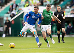 Hibs v St Johnstone…22.09.21  Easter Road.    SPFL<br />Paul McGinn tries to tackle Michael O'Halloran<br />Picture by Graeme Hart.<br />Copyright Perthshire Picture Agency<br />Tel: 01738 623350  Mobile: 07990 594431