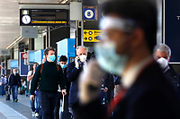 Termini Station people in the station and on the train platform<br /> Rome May 4th 2020. Covid-19, Italy enters the phase two of the coronavirus emergency. Photo Samantha Zucchi Insidefoto
