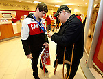 Ottawa, ON - March 28 2014- Ben Delaney shows his sledge hockey bronze medal to a local supporter. (Photo: Patrick Doyle/CIBC)