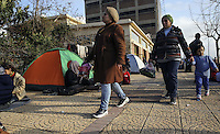 Pictured: Migrants camp by the passenger terminal Friday 26 February 2016<br />Re: Hundreds of refugees that crossed the border from Turkey to the Greek islands, have arrived at the port of Piraeus near Athens, Greece
