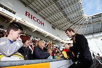 Photo: Richard Lane/Richard Lane Photography. Wasps Open Training Session at the Ricoh Arena ahead of their first game at the stadium. 16/12/2014. Joe Launchbury signs autographs.
