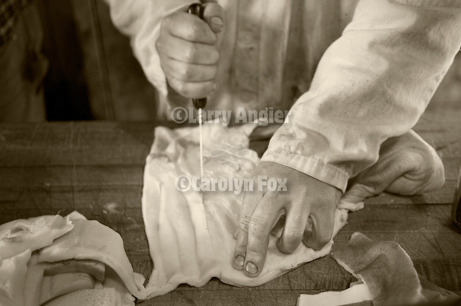 Cutting the bacon fat for making lard. Annual post-Christmas hog slaughter at the Cuneo Ranch near Jackson, in the California foothills.