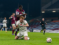 9th January 2021; Turf Moor, Burnley, Lanchashire, England; English FA Cup Football, Burnley versus Milton Keynes Dons; Dean Lewington of MK Dons on the floor under pressure from Mumbongo