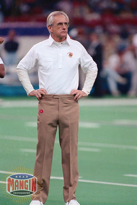 NEW ORLEANS, LA - Head coach George Seifert of the San Francisco 49ers stands on the field before Super Bowl XXIV against the Denver Broncos at the Superdome in New Orleans, Louisiana on January 28, 1990. Photo by Brad Mangin.