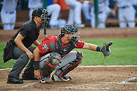 Pabel Manzanero (47) of the Billings Mustangs on defense against the Ogden Raptors while umpire Rene Gallegos handles the calls at Lindquist Field on August 18, 2018 in Ogden, Utah. Billings defeated Ogden 6-4. (Stephen Smith/Four Seam Images)