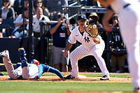 New York Yankees first baseman Mike Ford (72) takes a pickoff attempt throw as Cavan Biggio (8) dives back to the bag during a Spring Training game against the Toronto Blue Jays on February 22, 2020 at the George M. Steinbrenner Field in Tampa, Florida.  (Mike Janes/Four Seam Images)