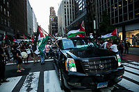 NEW YORK, NY - JUNE 15: A pro-Palestinian group wave flags next to a car during a large protest in New York on June 15, 2021. The solidarity action of hundreds of pro-Palestinians is a form of support against the attacks carried out by the Israeli government. At the same time, Palestinian Prime Minister Mohammad Shtayyeh says the new Israeli government is just as bad as the old one and condemns Naftali Bennett's announcements in support of Israeli settlements. That is why the demonstrations continue in different parts of the world. (Photo by Pablo Monsalve / VIEWpress via Getty Images