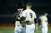 Wake Forest Demon Deacons catcher Logan Harvey (15) hugs relief pitcher Rayne Supple (9) after he closed out the game against the Liberty Flames at David F. Couch Ballpark on April 25, 2018 in  Winston-Salem, North Carolina.  The Demon Deacons defeated the Flames 8-7.  (Brian Westerholt/Four Seam Images)