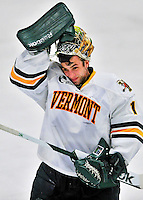 27 January 2012: University of Vermont Catamount goaltender John Vazzano, a Senior from Trumbull, CT, adjusts his mask after a game against the Northeastern University Huskies at Gutterson Fieldhouse in Burlington, Vermont. The Catamounts fell to the Huskies 8-3 in the first game of their 2-game Hockey East weekend series. Mandatory Credit: Ed Wolfstein Photo
