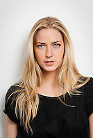 Young blonde woman looking at camera