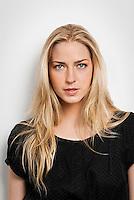 Young blonde woman looking at camera