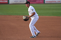 Wisconsin Timber Rattlers third baseman Dustin DeMuth (12) during a game against the Cedar Rapids Kernels on May 4th, 2015 at Fox Cities Stadium in Appleton, Wisconsin.  Cedar Rapids defeated Wisconsin 9-3.  (Brad Krause/Four Seam Images)
