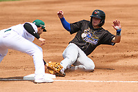 Quad Cities River Bandits third baseman Nathan Eaton (8) slides into third base as Beloit Snappers third baseman Kole Enright (8)  puts a tag on him during a game on July 18, 2021 at Pohlman Field in Beloit, Wisconsin.  (Brad Krause/Four Seam Images)