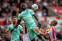 11th September 2021;  Bet365 Stadium, Stoke, Staffordshire, England; EFL Championship football, Stoke City versus Huddersfield Town; Naby Sarr of Huddersfield Town climbs to head the ball clear