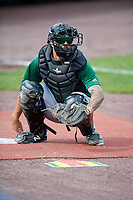 Clinton LumberKings Nick Thurman (9) warms up a pitcher in the bullpen before a game against the West Michigan Whitecaps on May 3, 2017 at Fifth Third Ballpark in Comstock Park, Michigan.  West Michigan defeated Clinton 3-2.  (Mike Janes/Four Seam Images)