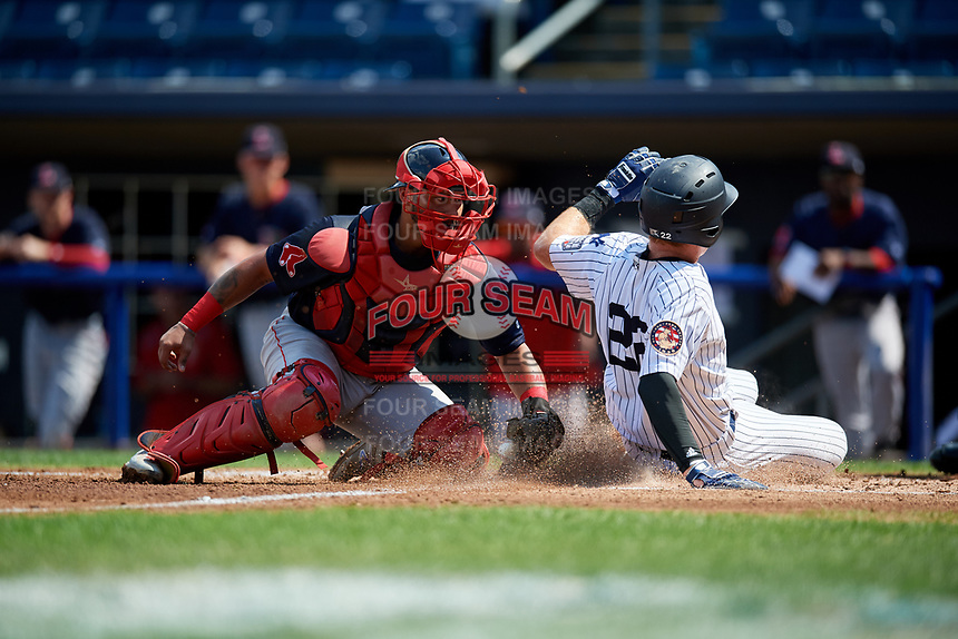 Lowell Spinners catcher Alberto Schmidt (20) tries to tag Bill Springman (22) as he slides home safely during a game against the Staten Island Yankees on August 22, 2018 at Richmond County Bank Ballpark in Staten Island, New York.  Staten Island defeated Lowell 10-4.  (Mike Janes/Four Seam Images)