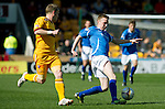 Motherwell v St Johnstone....28.04.12   SPL.Derek Riordan is tracked by Steven Hammell.Picture by Graeme Hart..Copyright Perthshire Picture Agency.Tel: 01738 623350  Mobile: 07990 594431