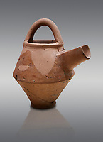 Hittite terra cotta side spout with stainer basket handles pitcher . Hittite Period, 1600 - 1200 BC.  Hattusa Boğazkale. Çorum Archaeological Museum, Corum, Turkey