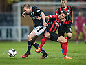 Dundee's David Clarkson and St Johnstone's Chris Millar challenge for the ball.