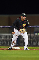 Quad Cities River Bandits first baseman Bryan Muniz (12) during the second game of a doubleheader against the Wisconsin Timber Rattlers on August 19, 2015 at Modern Woodmen Park in Davenport, Iowa.  Quad Cities defeated Wisconsin 8-1.  (Mike Janes/Four Seam Images)