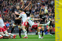 Danny Care of Harlequins ends up a box kick as George Kruis, Jacques Burger and Neil de Kock of Saracens attempt to block it