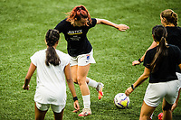 PORTLAND, OR - SEPTEMBER 30: Morgan Andrews #12 of the OL Reign flicks the ball before a game between OL Reign and Portland Thorns FC at Providence Park on September 30, 2020 in Portland, Oregon.