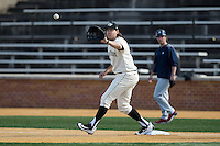 Will Craig (22) of the Wake Forest Demon Deacons waits for a throw at first base during the game against the Richmond Spiders at David F. Couch Ballpark on March 6, 2016 in Winston-Salem, North Carolina.  The Demon Deacons defeated the Spiders 17-4.  (Brian Westerholt/Four Seam Images)