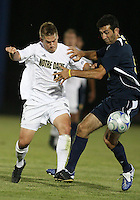 Matt Armstrong #15 of the University of Notre Dame tackles Justin Meram #9 of the University of Michigan during a men's NCAA match at the new Alumni Stadium on September 1 2009 in South Bend, Indiana. Notre Dame won 5-0.