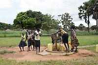N. Uganda, Gulu District. Peter C. Alderman Foundation project. N. Uganda, Gulu District. Peter C. Alderman Foundation project. Children pumping water from the well at the rural clinic.