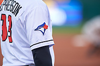 A detailed look at the Toronto Blue Jays logo on the sleeve of Lansing Lugnuts manager Dallas McPherson (33) during a Midwest League game against the Wisconsin Timber Rattlers at Cooley Law School Stadium on May 1, 2019 in Lansing, Michigan. Wisconsin defeated Lansing 2-1 in the second game of a doubleheader. (Zachary Lucy/Four Seam Images)