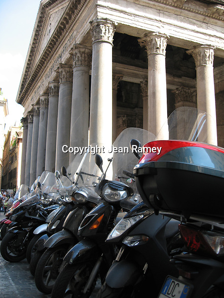 Trendy Italian Vespas sit aside the enduring Pantheon in Rome, Italy.