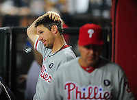 Apr. 25, 2011; Phoenix, AZ, USA; Philadelphia Phillies pitcher Cliff Lee (left) reacts after being pulled from the game in the eighth inning against the Arizona Diamondbacks at Chase Field. Mandatory Credit: Mark J. Rebilas-