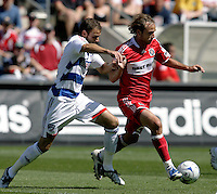 Chicago Fire midfielder Justin Mapp (21) is pressured by FC Dallas defender Daniel Torres (4).  FC Dallas defeated the Chicago Fire 3-0 at Toyota Park in Bridgeview, IL on May 31, 2009.