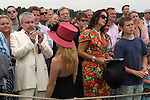 The Guards Polo Club, Windsor Great Park. England. Crowd watching the Queen give prizes out.