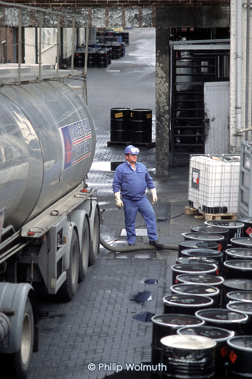 A tanker driver makes a delivery to the Sun Chemicals printing inks factory in Watford