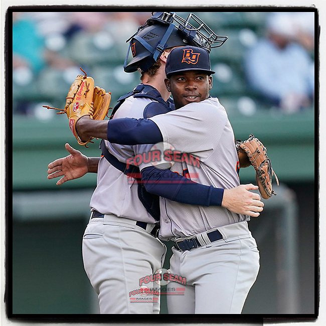 Closing pitcher Ezequiel Zabaleta (36) of the Bowling Green Hot Rods celebrates a 7-5 win over the Greenville Drive with catcher Blake Hunt (3) on Thursday, May 6, 2021, at Fluor Field at the West End in Greenville, South Carolina. (Tom Priddy/Four Seam Images)